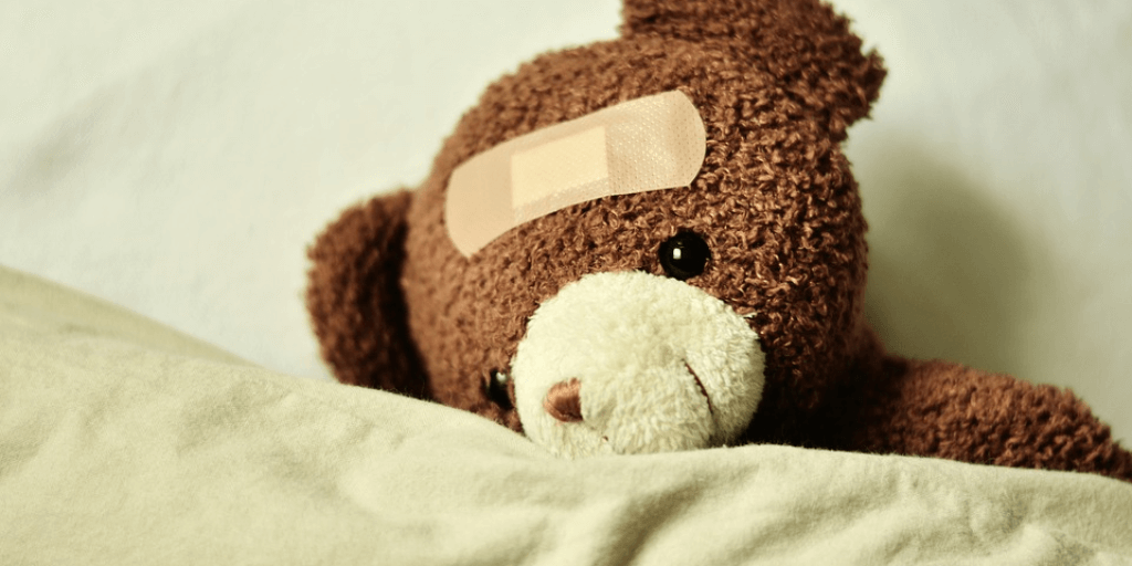 Teddy Bear with Band-Aid representing adult with disability needing care.