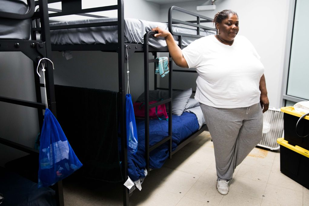 LaToya Washington stands inside her small room with four beds at Mary's Place diversion shelter. (Photo by Matt M. McKnight/Crosscut)